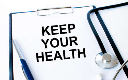 Text Keep your Health on a sheet in the medical folder with a phonendoscope and pen