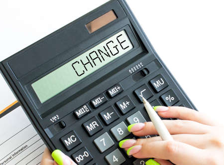A calculator with text Change on the display. Business and financial concept
