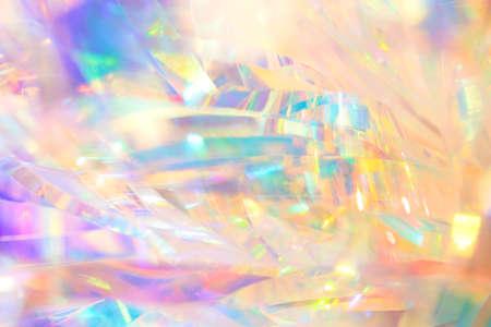 Rijke levendige gepolijste elegante abstracte achtergrondstructuur van holografische vakantiefolie lintdecoratie in pastel goud, aqua en paarse kleuren met glanzend kristal sprankelend fel licht reflecties