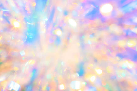 Abstract soothing calm girly princess background texture of holiday tinsel ornament with soft delicate gold and purple pastel colored glow and crystal glittering bokeh light reflections Imagens