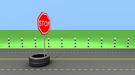 Stop sign and Wheel on the road photo