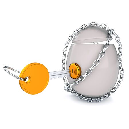 Egg held down by a chain and a gold key Stock Photo - 17009177