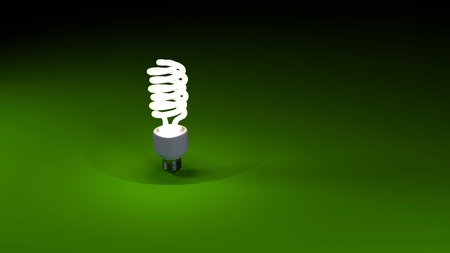 Energy saving lamp and simple light over green photo