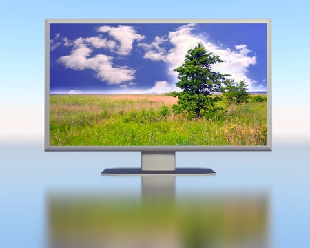 Display with image of landscape on the blue background photo
