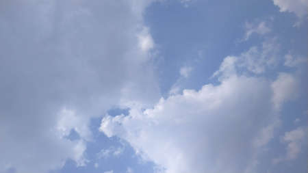 Beautiful blue sky with clouds for any copy space background