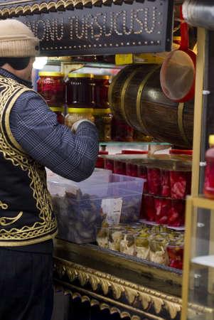 ISTANBUL,TURKEY,JANUARY 30,2011:Street peddler selling pickle in a small barrow at Eminonu region Editorial