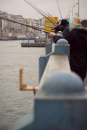 ISTANBUL,TURKEY,JANUARY 30,2011- Peoples fishing on the galata bridge at eminonu region Editorial