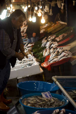 ISTANBUL,JANUARY 30,2011:Fish sellers bargaining with a costumer at eminonu region Editorial