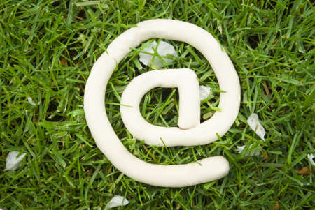 e mail symbol on the grass Stock Photo