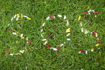 SOS letters on the grass