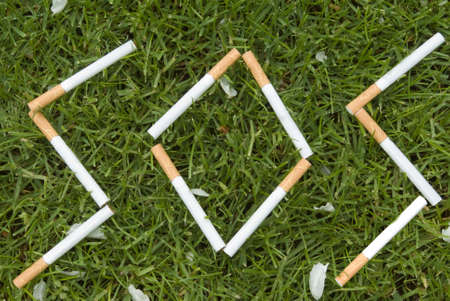 Cigarette letters on the grass