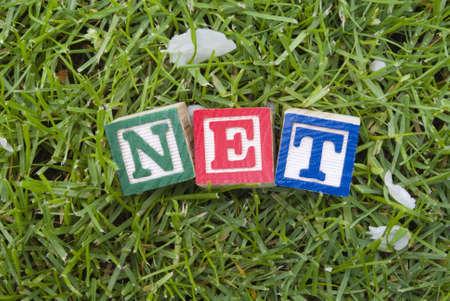 Net letter blocks on the grass