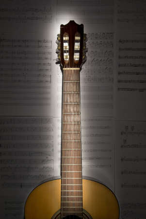 guitar in front of sheet music Stock Photo