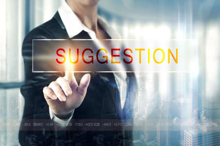 Business women touching the suggestion screen Stock Photo