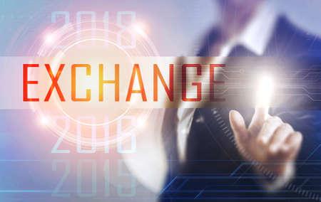 Business women touching the Exchange screen