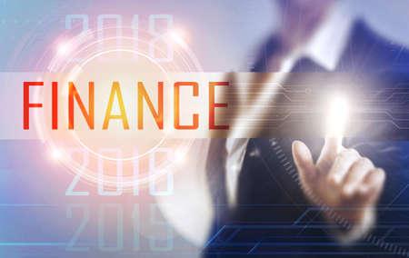 Business women touching the Finance screen