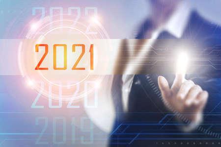 Business women touching the 2021 screen Imagens