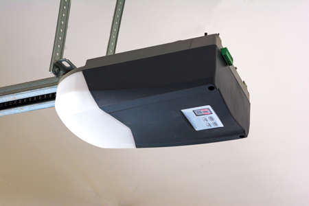 Close-up of an automatic garage door opener motor.