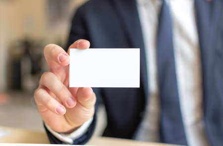 Business Card Mock-Up - Businessman Holding a Blank Card for Clients. Business Card Template.