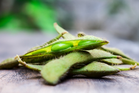 Pile Up of Boiled Green Edamame or Soybean On The Wood
