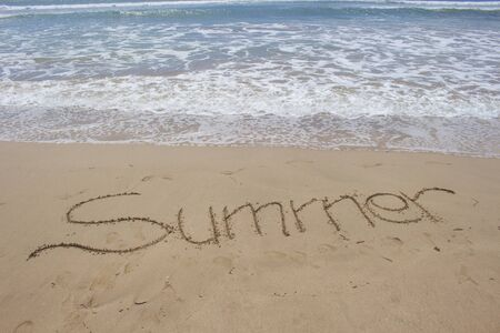Writing Summer With Blue Sea Water on The Beach