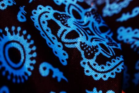 Abstract Background Close Up Blue Batik pattern on Black fabric
