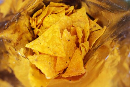 Close Up Yellow Corn Chip Snack in Aluminum Foil