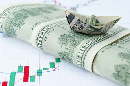 Ship made of money on wave of dollar notes on the exchange chart background photo