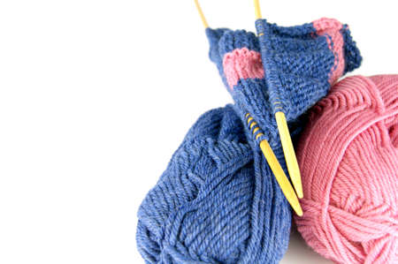 Knitting. Two balls two needles with a cloth on a white background Stock Photo - 9879352