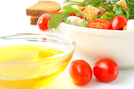 Mixed salad with cherry tomatoes, arugula, mozzarella and olive oil on white background Stock Photo - 9879350