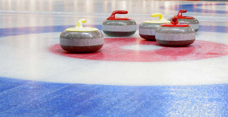curling: Granite stones for curling game on the ice