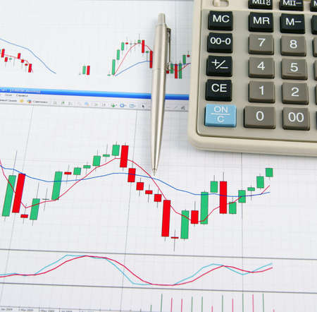 Calculator and pen on the exchange chart background Stock Photo - 10083010