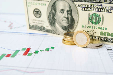 Dollar note and euro coins on the exchange chart background Stock Photo