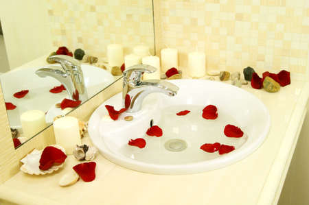 sink in a bathroom, beautiful sink in a bathroom with candles and petals of roses