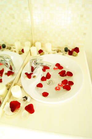 sink in a bathroom. beautiful sink in a bathroom with candles and petals of roses Stock Photo - 10083014