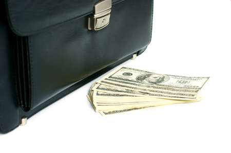 Black briefcase and money isolated on white background