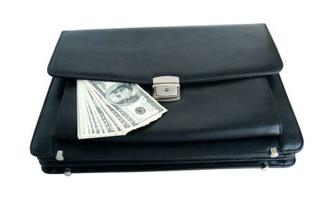 Black briefcase and money isolated on white background photo