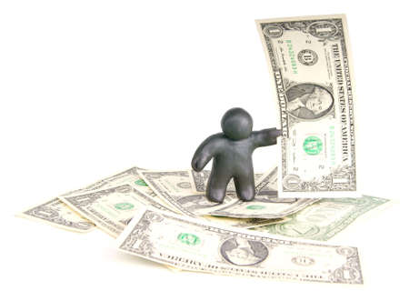 plasticine man with banknote one dollar on dollar background