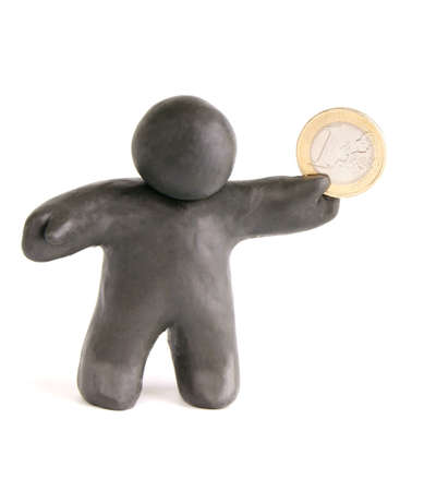 The plasticine man holding a one euro coin in his hand on a white background Stock Photo - 60236766