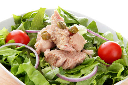 international salad whit tuna onion end tomato photo
