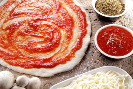 preparation of the Neapolitan pizza with tomato sauce