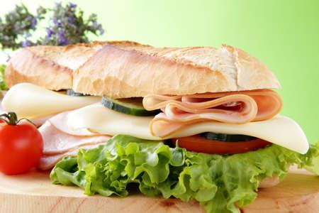 ham cheese sandwich with cucumbers photo