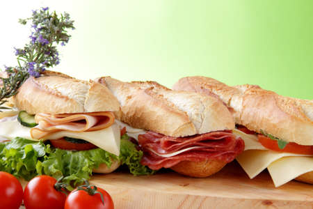Assorted sandwiches with salami, ham, cheese