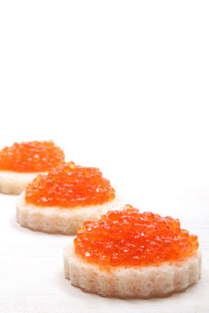 salmon eggs on a white background