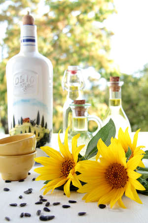 sunflower oil 0n wood table with natural background