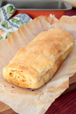 whole strudel baked on a sheet of paper Stock Photo - 15353315