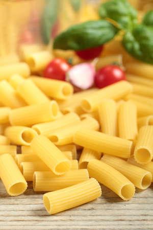 maccheroni: Italian pasta maccheroni rigatoni on table Stock Photo