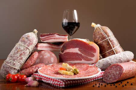 to cut: composition of mixed Italian cold cuts on wooden table