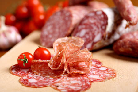 Italian cold cuts on wooden table