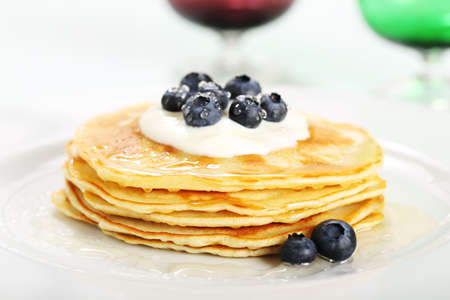 pancakes with blueberry yogurt and honey on plate